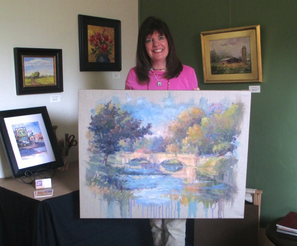 Lesley Haflich displays an oil painting. (submitted photo)