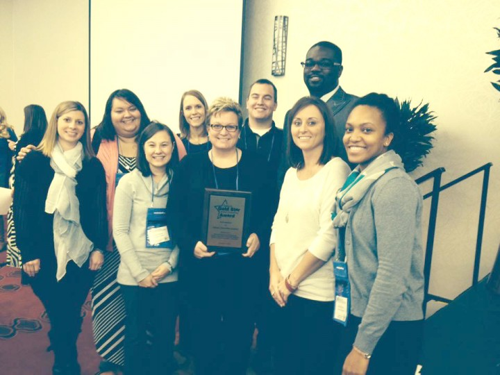 From left: Lauren Gross, Jessica Briones, Sonia Norman, Jennifer McClimon, Melissa Brown, Curt Oechsle, Brandon Currie, Angela Spoljaric and Jeniece Fleming celebrate INCA's Indiana Gold Star School Counseling Award, which they also received from ASCA for its counseling program. (Submitted photo)