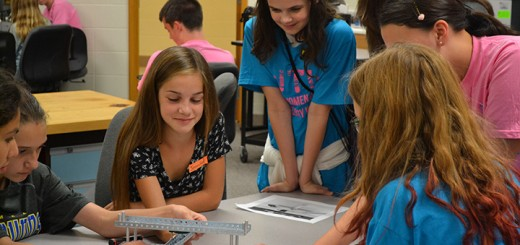 From left: Renee Johnson, Jennifer Kerr, Keeley Cassady, Elaina Johnson-Glaser, Alexandra LaMear and Lydia Rusin work together at the Women in Technology Workshop. (Photo by Amanda Foust)