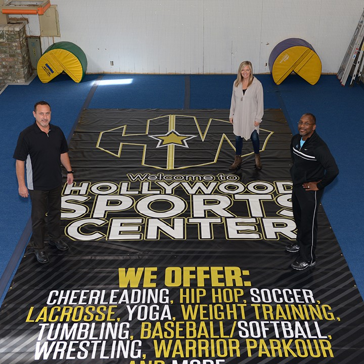 John Kirk, Margi Beaver and Patrick Cowherd inside the new Hollywood Sports Center. (Photo by Theresa Skutt)