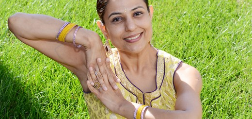 Archana Thaker in a seated dance position. Thaker teaches Indian Bollywood dance to young women in Carmel. (Photo by Theresa Skutt)