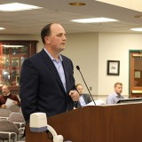 Fishers Mayor Scott Fadness presents the Indianapolis Airport Authority memorandum of understanding before the city council. (Photo by James Feichtner)