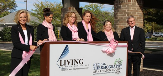 Living with Intention Executive Director Linda Elliott, from left, Holly Skinner, Kelly Keesling, Mary Jo Rothenbush and Amanda Vincent and Dr. Stephen Elliott at the ribbon cutting for Living with Intention's medical thermography location in Fishers. (Photo by James Feichtner)