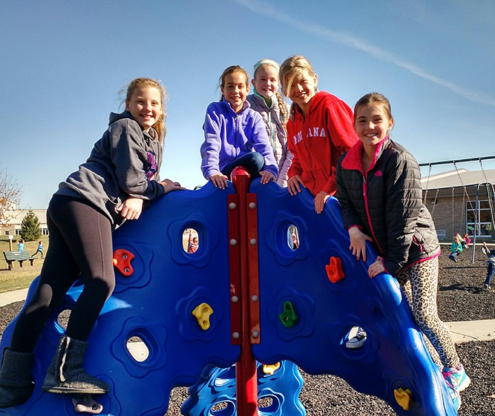 From left, Claire Castor, Megan Pause, Lauren Reifel, Emily Gentry and Allie McKeown, all fifth graders, play on the new climbing structure at Westfield Intermediate School. (Submitted photo)