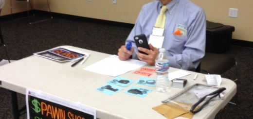 Steve David served as the owner of the pawn shop in the poverty simulation. He videotaped everyone who came to the shop on his phone. (Photo by Kelsey Ligon)