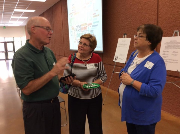 Former ZEF board member, Andrew O'Donnell, and former ZEF grant awardees Barb Burkhardt and Paulette Berger talk at a reunion in September. (submitted photo)