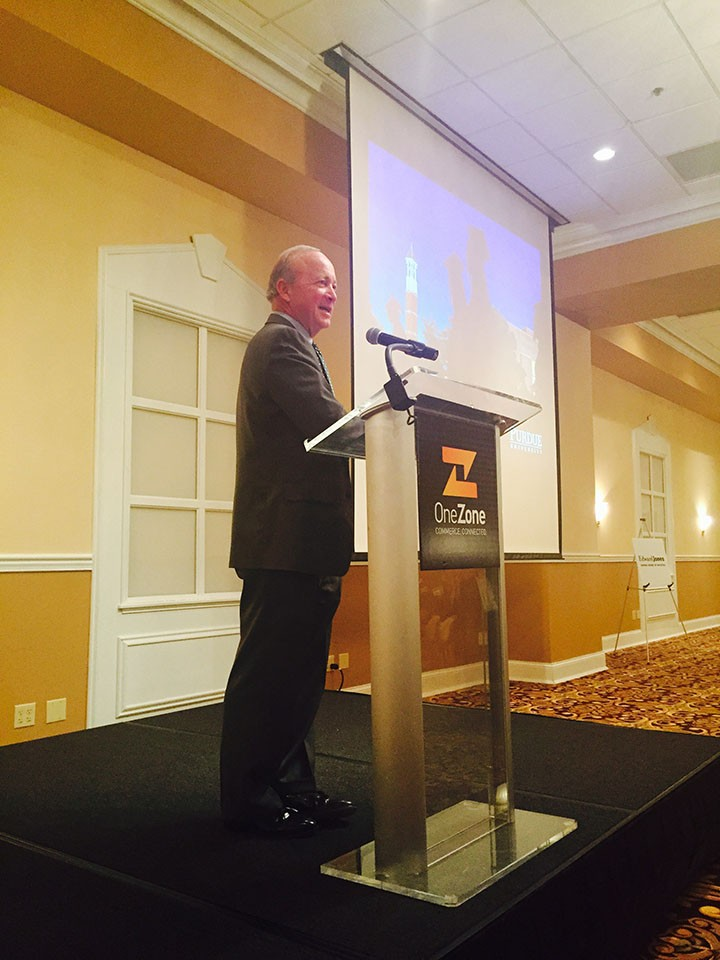 Mitch Daniels speaks to a crowd of OneZone members in Carmel Oct. 22. (Photo by Adam Aasen)