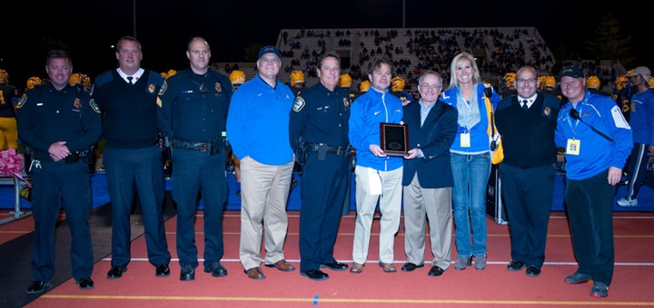 Officials from Carmel High School, the Carmel Police Dept. and the Carmel Fire Dept. accept a plaque in honor of the school's Sport Event Security Awareness designation. (submitted photo)