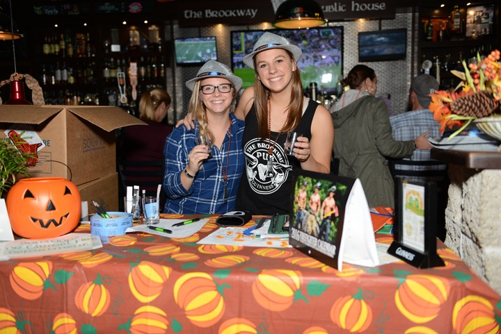 Clare Crumback and Molly Cason hold up their glasses at Brocktoberfest. (Photo by Theresa Skutt)