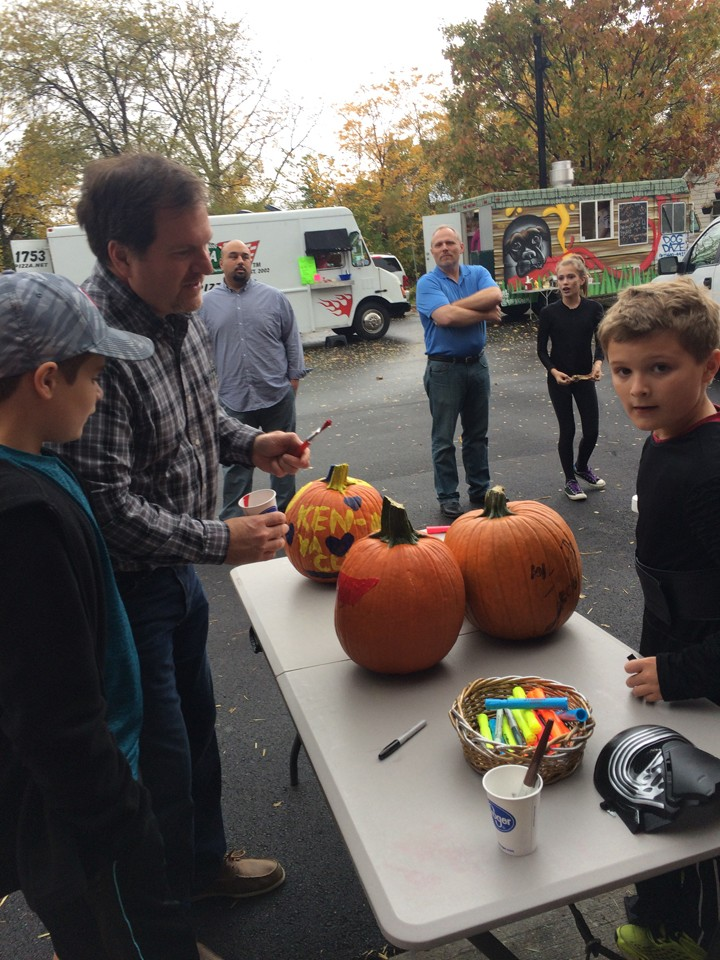 Ted, Zachary and William Spurgeon of Cicero at the pumpkin-decorating table. (Photo by Kayla Nakeeb)