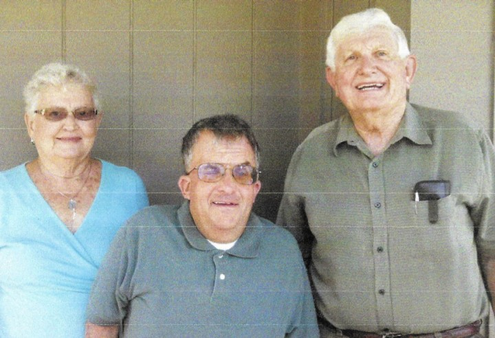 Doug Dolen, center, was one of the first students in College Wood's special education program. Former teacher Connie Hunt, left, and former principal Jim Moore were instrumental in the program. (submitted photo)