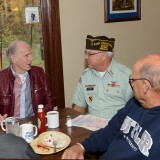 VFW Post 10003 Commander Richard Leirer, center, speaks with Mickey Deering, a Korean War veteran and Richard Deering, a Vietnam War veteran, during breakfast Oct. 31. (Photo by Theresa Skutt)