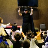 Jerry Zehr performs a magic show for a group of children. (submitted photo)