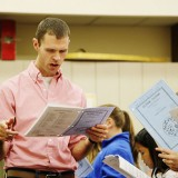 Josh Pedde directs the Carmel Children's Choir during a rehearsal. (Photo by Feel Good Now)