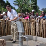 Fishers Rotarian Tom Branum Jr. pumps water from one of the established water wells in Sierra Leone. (Submitted photo)