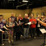 The Fishers Community Choir rehearses for their upcoming premiere performance on Dec. 5. (Photo by James Feichtner)