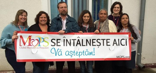 """The ZPC team helped launch MOPS at a church in Giurgiu, Romania. Team members include, from left, Michele Sutton, Mindi McMillan and Lisa Price, second from right. The sign states in Romanian, """"MOPS meets here. All are welcome."""" (Photo by Lisa Price)"""