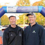 Don Carr, left, and his brother, Phil, at the Brain Bolt 5K in October at Marian University. Their company, Tux Bros., managed the race. (Photo by Theresa Skutt)