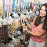 Carolina Locker displays a necklace from Colombian Girl Jewelry stored in her basement. (Photo by Ann Marie Shambaugh)