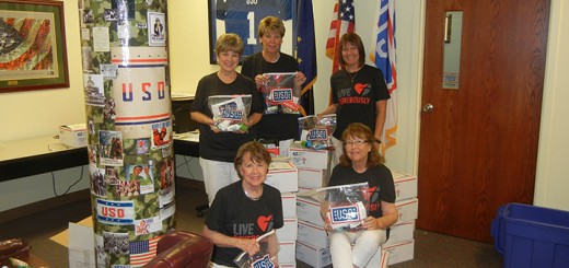 Sandy Hughey, lower right, with some of the USO volunteers. (Submitted photo)