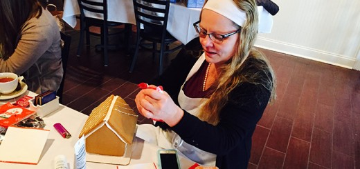 Beth Aasen, owner of Donatello's Italian Restaurant, makes a gingerbread house.