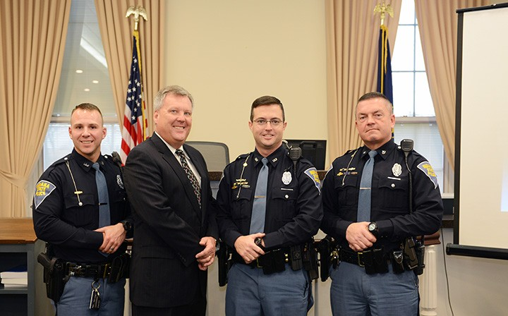 Carmel City Judge Brian Poindexter, second from left, opened his chambers for a presentation from the Indiana State Police troopers – from left, Ryan Kenworthy, Jon Caddell and Aaron Gaul – on how to respond in an active shooter situation. (Photo by Theresa Skutt)