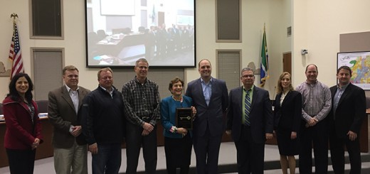 From left, councilors Cecilia Coble, Todd Zimmerman, Peter Peterson, Rich Block, Conner Prairie CEO Ellen Rosenthal, Fishers Mayor Scott Fadness, councilors John Weingardt, Selina Stoller, David George and Eric Moeller. (Photo by James Feichtner)