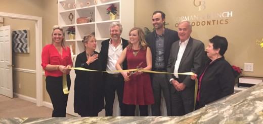 From left, Heather Gordon, Julie Sole, Dr. Courtney Gorman, Dr. Carly Ahlbrecht, Dr. Jason Bunch, Mayor Andy Cook and Jo Ann Weiker cut the ribbon for the ceremony to open Gorman and Bunch Orthodontics in Westfield at 16407 Southpark Dr.