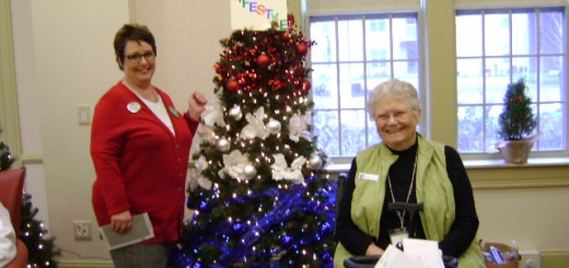 Maryellen Keen and Barb Story stand next to one of the Christmas trees. (submitted photo)
