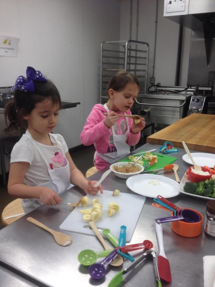 From left, Emma Parcell and Ella Johnson participate in the Kids Rule Cooking School. (submitted photo)