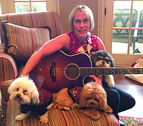 Singer Sandi Smith with her dogs and guitar. (Photo by Mark Ambrogi)