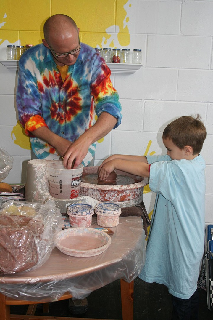 Jeremy South, left, helps a student at The Art Lab. (Submitted photo)