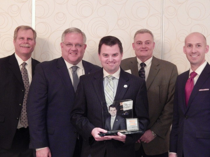 Jerry Daniken, branch manager of the Carmel Citizens State Bank office, John DeLucia, chief lend- ing officer at Citizens State Bank, Elliott Somers, who was named the young Professional of the year, Roger Wells, retail banking director at Citizens State Bank, and Dan Maddox, chief operating officer at Citizens State Bank. (Submitted photo)
