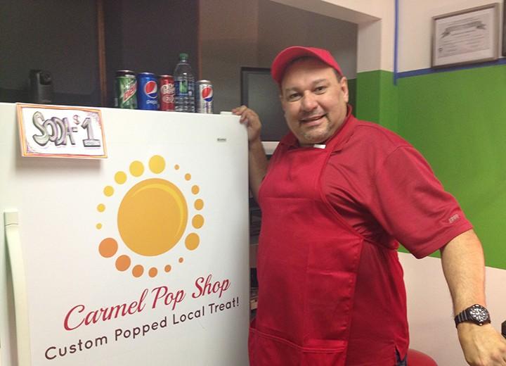 Lou Sanchez inside his new popcorn store, Pop Shop. (Photo by Audrey Bailey)