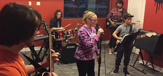 Fishers School of Rock students rehearse for their upcoming Jan. 23 concert at Alley's Alehouse. From left, guitarist Devon Lehr, drummer Simon Gardner, vocalist Maggie Adolay, bassist Kaia Eby- Holmes and guitarist Keegan Phillips. (Submitted photo)
