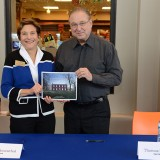 "Former Conner Prairie president and CEO Ellen Rosenthal and photographer Thomas Mueller display their book, ""Conner Prairie,"" during a signing Dec. 12 at the museum's Welcome Center. (Photo by Theresa Skutt)"