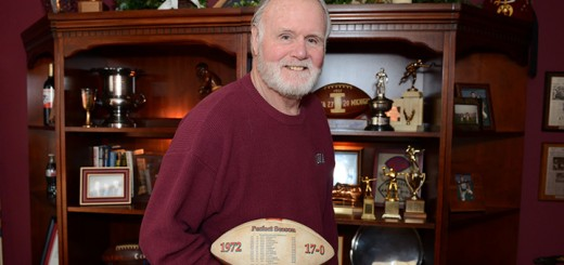 Former Super Bowl champion Doug Crusan with memorabilia from his college football and NFL career, in his Fishers home. (Photo by Theresa Skutt)