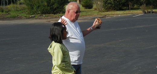 Tim Hahn works with a young girl to translate at one of the Helping Hand events. (Submitted photo)