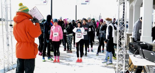 Runners at the 2015 Melt the Trail 5K Run prepare to start their race in the snowy weather. (Submitted photo)