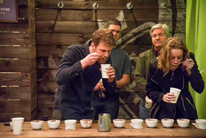 Kyle Kmetz (left taster), corporate trainer from Hubbard and Cravens hosted the cupping event on Jan. 9. He had three volunteers from the office help him try coffees.  (Submitted photo)