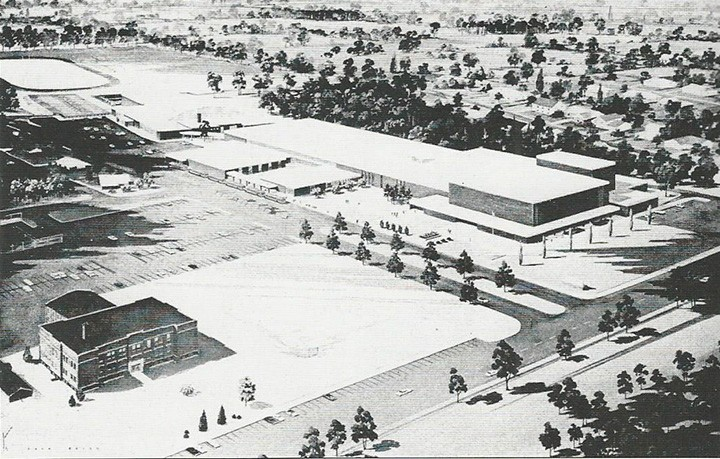 The illustration from a 1970 dedication program for a new addition shows the 1921 building next to the current one. The president of the Board of Education in 1970 was Richard Helmut, superintendent of schools was Dr. Robert Hartsmann, and the principal was Dale E. Graham. (Photo courtesy of the Carmel Clay Historical Society)