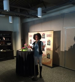 Chef Carla Hall speaks to her fans at Market District. (Photo by Steven Aldrich)