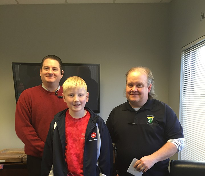 From left, Dan Mixan of Market District, student Ethan Campbell and teacher Chad Inman at the Teacher of the Month luncheon. (Photo by Anna Skinner)