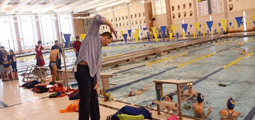 Carmel High School girls swimming coach Chris Plumb gives instruction during a practice session. (Photo by Theresa Skutt)