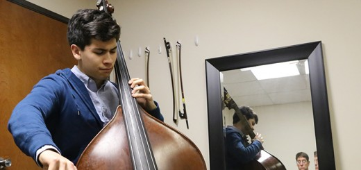 Aleck Belcher practices the double bass at Quattro String Academy. (Photo by Ann Marie Shambaugh)