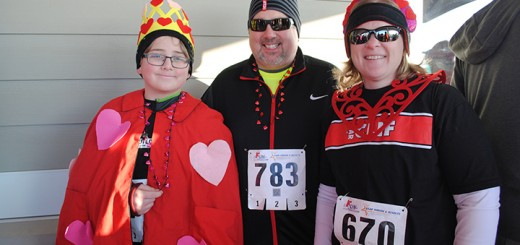 From left: Ethan, Dave and Carrie Tintelnot dress up in Valentine's Day costumes for the Melt the Trail 5K.