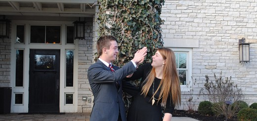 Siblings Andrew and Megan Hedges celebrate winning their scholarship with a high five. (Photo by Anna Skinner)