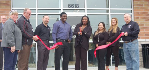 Dr. Nytarsha Thomas, fourth from right, cuts the ribbon in front of Visionelle Eyecare. Joining her, from left, are Whitestown executive assistant Johnetta Roberts, Whitestown Police Chief Dennis Anderson, Whitestown Town Manager Dax Norton, Tobe Thomas, Savannah Zwicker, Elenita Blackwell and Whitestown town councilor Kevin Russell. (Photo by Heather Lusk)