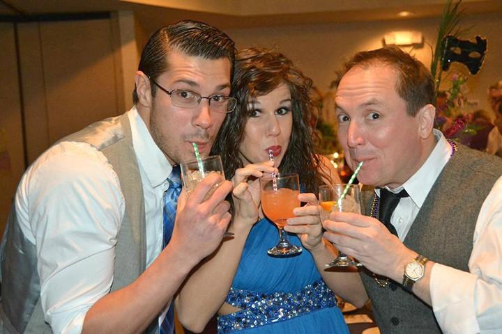 Logan Moore, Danielle Carnagua and ATI co- founder, Don Farrell at last year's ATI Mardi Gras party. (File photo)