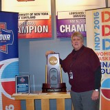 Fishers resident and NCAA director of championships and alliance Tina Krah shows off a replica of the trophy that will be given to this year's Women's Final Four champion in Indianapolis. (Photo by Sam Elliott)